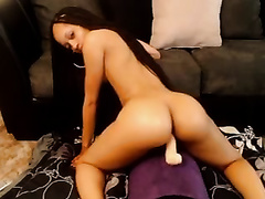 Long-haired beauty doesn't wish to stop riding a Sybian