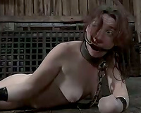 Poor thrall BBC slut looks like a dummy with her extremities handcuffed