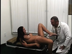 Trashy brunette hair with large fake milk shakes masturbates in front of her doctor