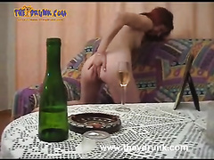 Redhead whore vomits in a water closet after playing with her cum-hole