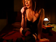 Lascivious redhead vixen on webcam teases me in different positions