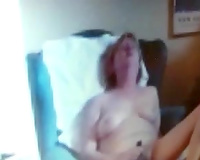 Old white blond wife pleasing herself in the bedroom