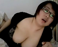 Busty Japanese brunette flashes her appetizing boobies