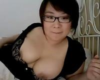 Busty Japanese brunette flashes her appetizing boobies