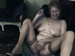 Horny granny on livecam stripteasing and masturbating