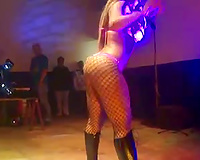 Black stripper with a large ass shakes it in the night club