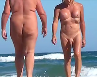 Blonde shemale with weird billibongs acquires caught on my hidden cam on a beach