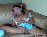 Pigtailed Filipino babe in knee socks copulates herself with her sextoy