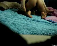Hidden webcam in the bedroom films how a stud bonks Asian BBC slut