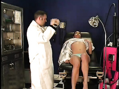 Nasty Asian harlot plays with large sex tool at gynecologist's office