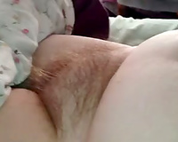 I love rubbing my girlfriend's hirsute twat in front of a camera