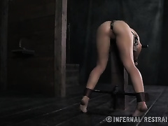 Sexy brunette hair wench wearing steel mask sucks a fake penis and receives it in her pussy