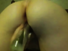 Chubby white bitch from behind pokes her pussy with big sex toy