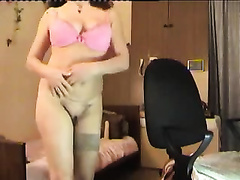 Four eyed old slutwife in glasses puts on a valuable striptease show