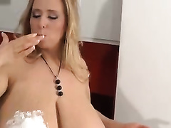 My huge-breasted wife smears her boobs with whipped ball cream