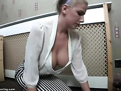 My blond secretary teases me with her terrific cleavage