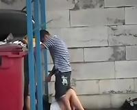 Hidden webcam vid with a youthful pair having blow job sex behind a dumpster