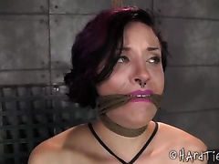 Busty bitch with dyed hair is fastened hard by her dark dom
