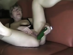 My lascivious blonde white women slams her butthole with a cucumber