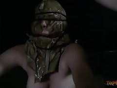 Bosomy doxy with a bag on her face is bounded with ropes and tortured