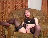 Amateur girl undresses down to her nylons in solo episode