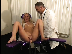 Lewd woman acquires pleasured by a fucking machine at a doctor's office