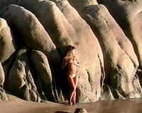 Breath-taking chick Racquel posing undressed on a beach