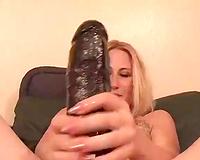Horny mama with fair hair masturbates with really big sex toy