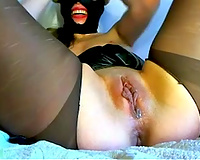 Masked doxy is doing magic tricks with her muff on web camera