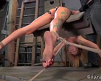Lustful blonde whore bounded on sharply angled wooden device