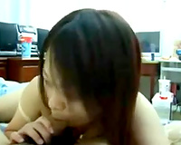 Skanky Asian gal simply loves giving head in front of a camera