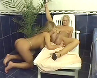 Blonde lesbian babes make out and toy slits in the bathroom