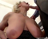 Big tittied mature woman gives sexy oral-service to her fuck buddy