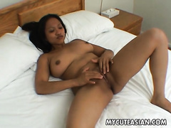 Pretty and busty Filipina fingers her hairless cum-hole to agonorgasmos