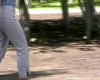 Busty Russian Married slut in constricted white pants voids urine in the park