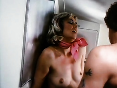 Hardcore retro sex scene with a golden-haired flight attendant