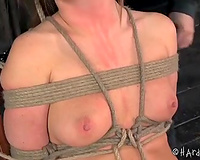 Blindfolded brunette hair beauty with puffy nipples bounded with ropes