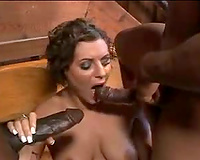 Curly hair housewife on her knees engulfing dark knobs