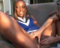 White stud eats out a dark cheerleader