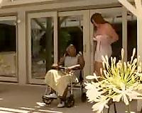 Black man in a wheelchair blown by nurse
