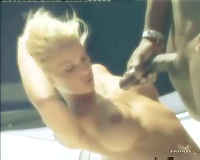 Black fellow copulates blond babe on a boat