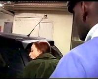 Redhead takes dark knob in a parking lot