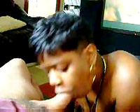 Ebony works a large white rod and swallows cum in a hawt manner