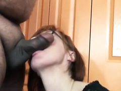 Red-haired milf in glasses sucks a miniature pecker indoors
