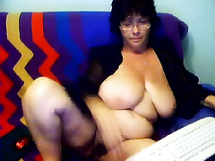 Mature brunette hair in glasses shows her boobs and slit for the cam