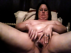 Fat bitch stimulates her thick twat with her marital-device
