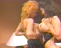 Slutty lesbians harlots rub their giant boobies in perverted retro porn movie scene