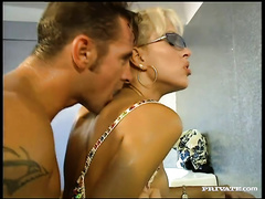 Tall whorish blondie acquires her holes rammed in the latrine