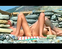 Awesome wild and obscene pair chilling on the nudist beach