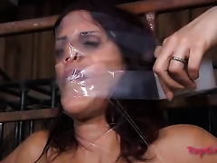 Slutty redhead is fastened up with a fishing line in this BDSM episode